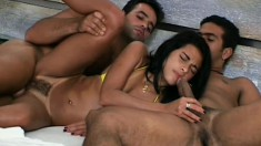 A sexy Brazilian girl gets some savage anal treatment from two men