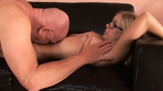 A nerdy blonde babe with hot breasts rides some throbbing meat