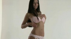 Incredible teen brunette Zara taking off white lingerie and stockings
