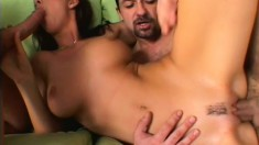 Buxom brunette with long legs invites two studs to stretch her holes