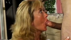 Horny MILF with enormous tits loves to swallow a young pecker