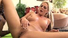 Sexy blonde Milf gobbles up a big black and gets plowed by it