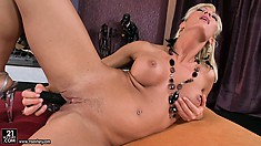 Super horny whore is doing herself with the nice dildo in front of camera guy