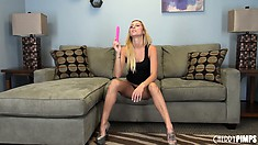 Blonde cutie Nikki Seven gets ready for a masturbation show on the couch