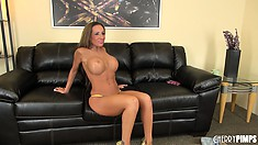 Brunette bimbo built like an amazon poses in a bikini and heels