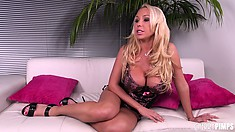 Mary Carey wears a tight corset that barely holds her huge tits
