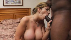 Voluptuous blonde cougar Sara Jay expresses her love for black meat