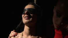 Submissive girl gets blindfolded and fucked by a gorgeous dominatrix