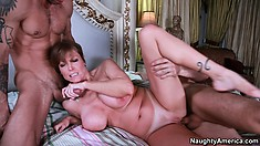 Darla Crane gets plowed hard by two young studs at the same time