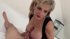 Curvaceous housewife puts her hands and lips to work on a long stick