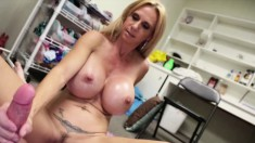 Brooke Tyler shows off her big round tits and jerks off a long stick