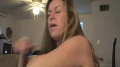 Trashy blonde hooker exposes her boobs and gives a blowjob POV style