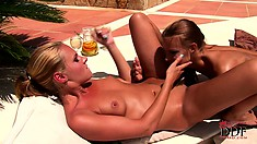 Lesbian cuties munching some pussy getting a nice tan under the sun