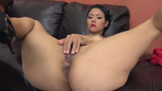 Buxom tattooed babe Dana gives her fiery pussy the attention it needs