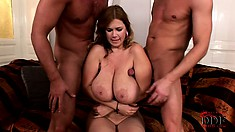 The stacked milf relishes the hardcore threesome and takes their cum on her boobs