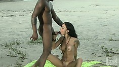 Brunette Brazilian beauty takes his big black boner in her ass on the beach