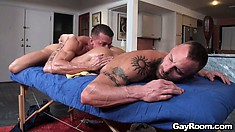 Naked masseur guy touches hard ass of his client and pours oil on it