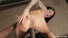 Showing her nice ass, she's taking his big black cock in her fuck hole
