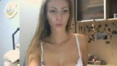 This Blonde Camgirl Owns Nice Tits And Ass