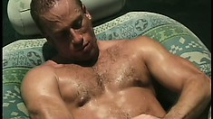 After jacking their cocks together, he fucks his ass from behind