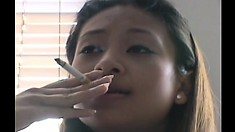 Pretty Asian schoolgirl with tiny tits strips off her clothes and blows a big dick