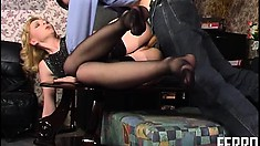 Hot blonde cougar in black stockings Olivia has a young stud licking her sexy feet