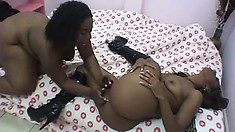 Plumper chocolate honey and her girlfriend play with the dildo together