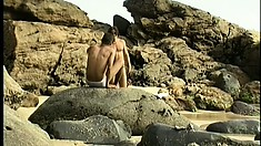 Sex on the beach in the hot sun is what this young gay couple crave