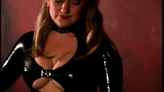Latex fetish mistress has her slaved wrapped up in latex to torture