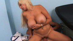 The doctor fondles a MILF's enormous titties before fucking her