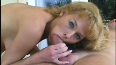 Naughty blonde masseuse seizes the chance to stick a cock in her mouth