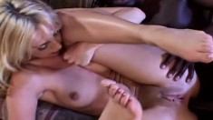 Trashy blonde Kelly Wells has a huge black rod deeply exploring her ass