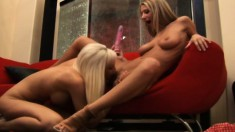 Blonde babe Sammie shows the charms of lesbian sex to a young chick
