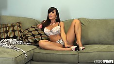 Big tit Milf Lisa Ann is on the couch teasing and talking live