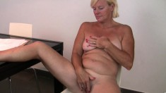 Mature blonde Sabine comes home from a hard day at work and fingers her twat