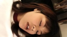 Sweet Japanese girl plays with a sex toy and reveals her oral skills