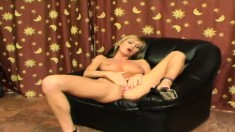 Sexy blonde spends some alone time rubbing her hairless twat