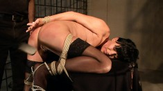 Dark-haired vixen lets this guy tie her up and play with her creamy slit