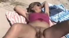 Blond milf shows off her pussy