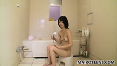 In the shower, the cute Asian babe Hiroe sensually soaps every inch of her hot body