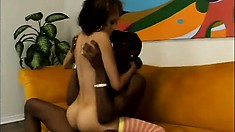 Skinny yellow bone bitch tries her luck at taming a big black cock