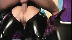 Submissive babe in a black latex outfit Dora has her master pounding her snatch