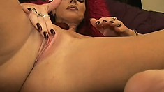 Nasty redhead cougar massages her big boobs and pleases her fiery cunt