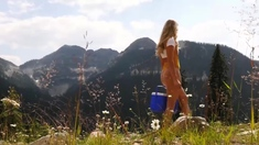 Beautiful blonde teenie babe outdoor strip at the alps