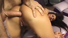 Brunette bimbo with huge fake tits gets wrecked by a large cock