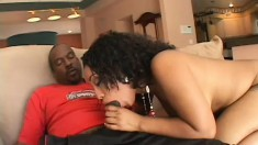 Flawless caramel girl has a huge black stick hammering her pink pussy
